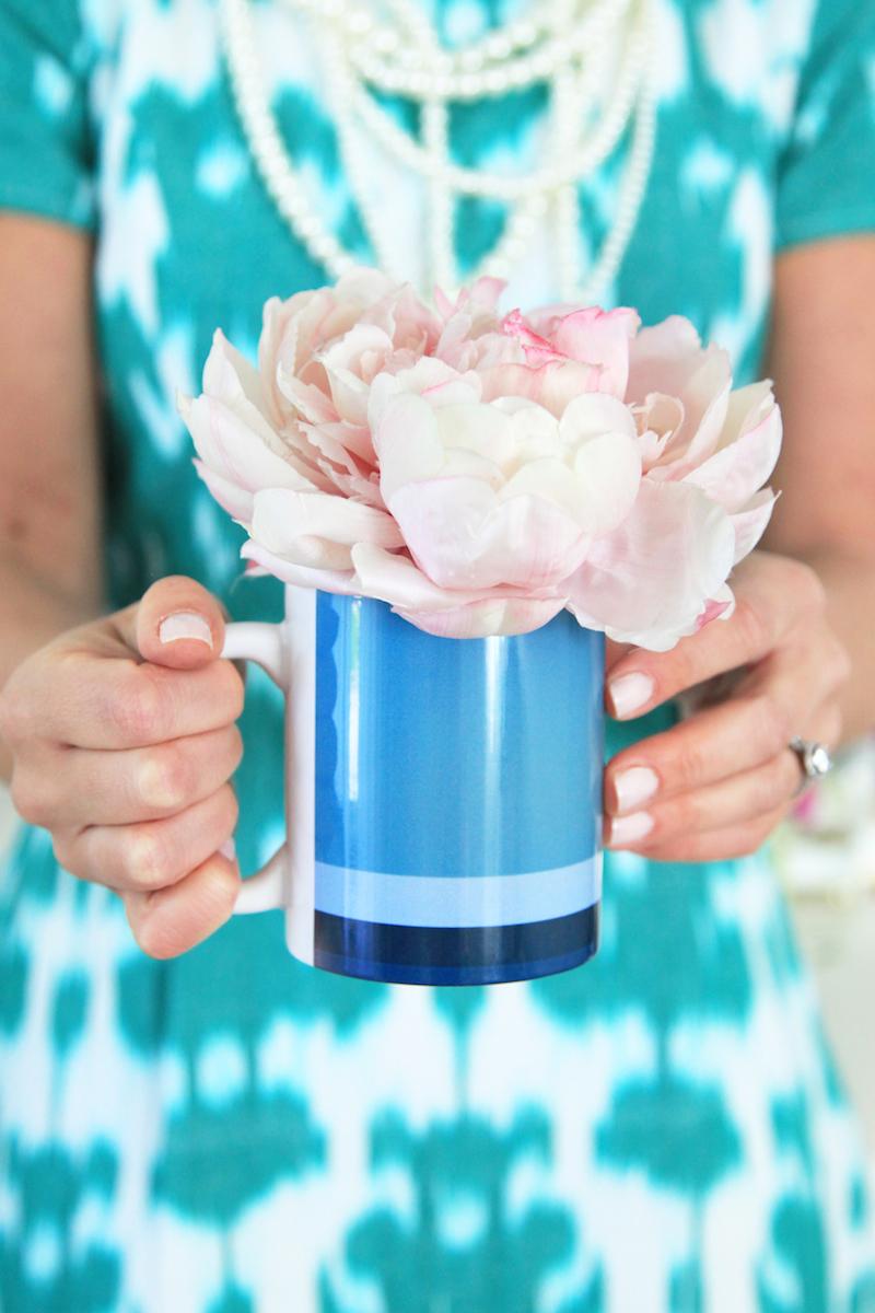 A peony in a blue mug