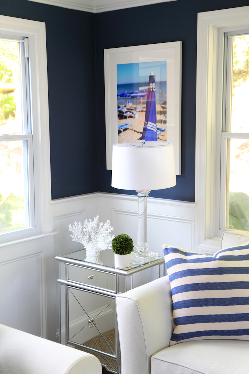 Navy walls in a sunroom